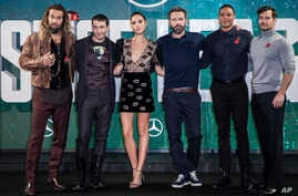 "FILE - This Nov. 3, 2017 file photo shows ""Justice League"" cast members Jason Momoa, from left, Ezra Miller, Gal Gadot, Ben Affleck, Ray Fisher and Henry Cavill at a photo call for the film in London."