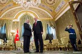 Russian President Vladimir Putin, left, shakes hands with Turkey's President Recep Tayyip Erdogan during their meeting in the Kremlin in Moscow, March 10, 2017.