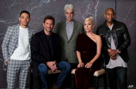 """Bradley Cooper, seated left, cast member and director of the film """"A Star is Born,"""" poses with actors, from left, Anthony Ramos, Sam Elliott, Lady Gaga and Dave Chappelle at the Four Seasons Hotel during the Toronto International Film Festival in Tor"""