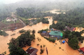 Flooding has displaced more than 100,000 in Malaysia, with high waters leaving roads impassable in its national park in Kuala Tahan, Pahang, shown Dec. 24, 2014.