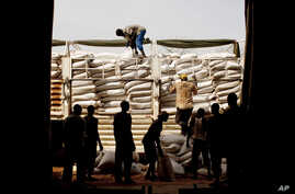 Workers unload food for distribution at the Yida refugee camp in Unity State, South Sudan. More than 30,000 refugees currently reside in Yida having fled war between the government of the Republic of Sudan and rebel forces in South Kordofan, May 12,