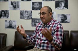 FILE - Activist lawyer Khaled Ali speaks to The Associated Press at his office in Cairo, Egypt, Feb. 6, 2017.