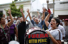 People gather in front of the Presidential House in Guatemala City, demanding the resignation of Guatemala's President Otto Perez Molina, Aug. 23, 2015.