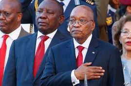 FILE - South African President Jacob Zuma, right, alongside deputy president Cyril Ramaphosa, left, outside parliament at the State of the Nation address in Cape Town, South Africa, Feb. 9, 2017.