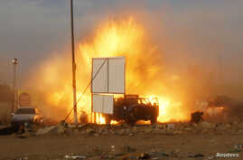 An explosion is seen during a car bomb attack at a Shi'ite political organization's rally in Baghdad, Iraq, April 25, 2014.