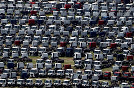 FILE - New Ford trucks are seen at a parking lot of the Ford factory in Sao Bernardo do Campo, Brazil, Feb. 12, 2015.