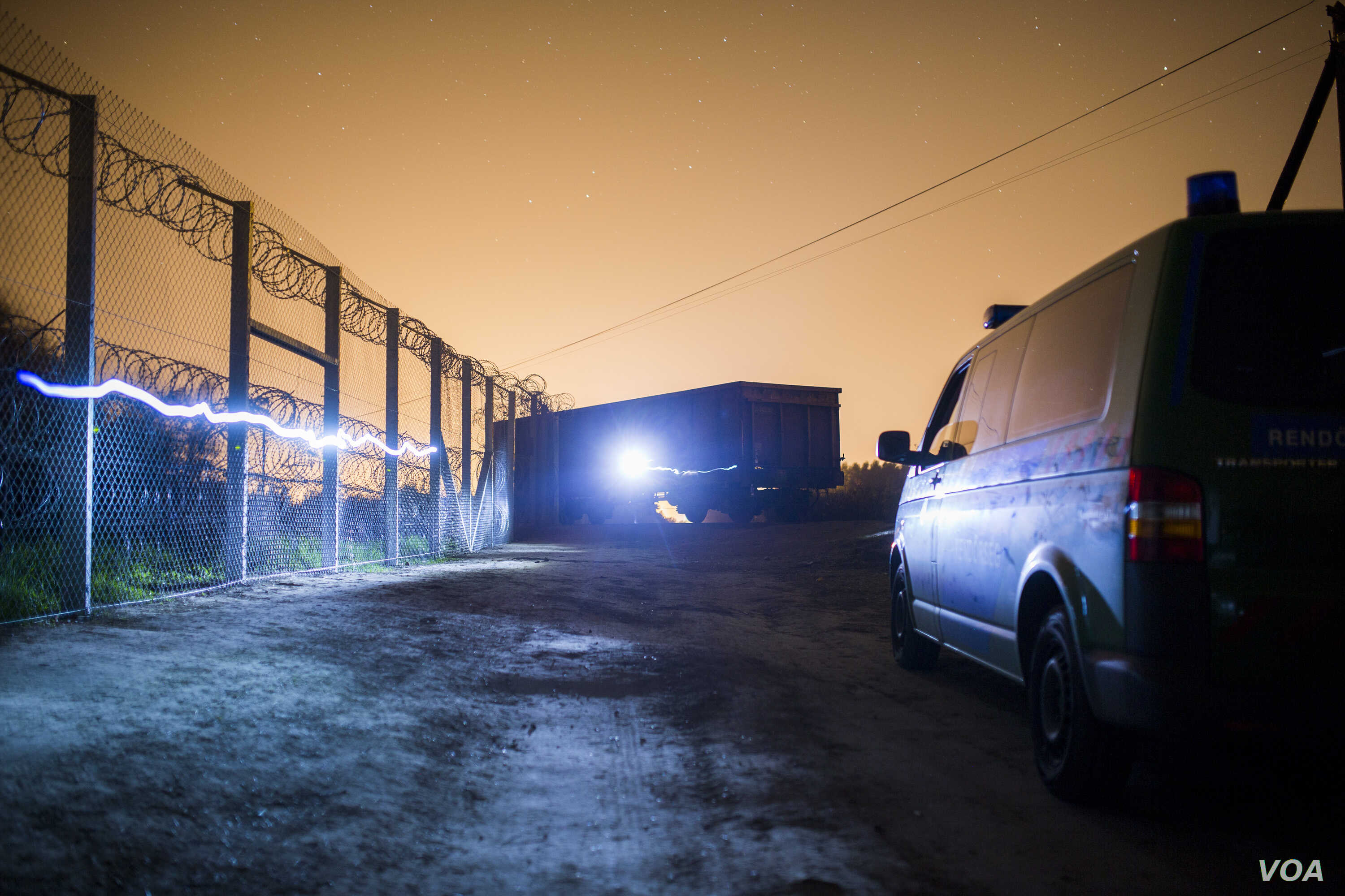 Night shots of the newly erected border fence in Asotthalom, Hungary. (Gabor Ancsin/VOA)