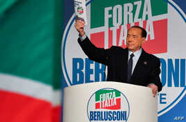 Former Italian prime minister Silvio Berlusconi holds a campaign booklet as he addresses a rally of right-wing Forza Italia party on March 30, 2019 at the Congress Center in Rome, ahead of the May 2019 European elections.