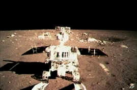 FILE - China's first moon rover 'Jade Rabbit' touch the lunar surface and leave deep traces on its loose soil.