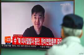 South Koreans watch a television news showing a video footage of a man who claims he is Kim Han-Sol, a nephew of North Korea's leader Kim Jong-Un, at a railway station in Seoul on March 8, 2017.
