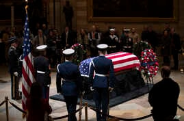 The last visitors pay respects to the late president, George H.W. Bush, as the public viewing comes to an end at the U.S. Capitol Rotunda, Dec. 5, 2018.