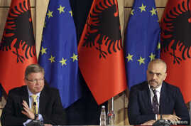 European Union Enlargement Commissioner Stefan Fuele (L) attends a news conference with Albania's Prime Minister Edi Rama, in Tirana, Albania, June 4, 2014.