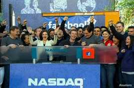 "Facebook Founder and CEO Mark Zuckerberg, shown in this image from Reuters video, rings the NASDAQ Stock Market Opening Bell remotely from ""Facebook"" headquarters in Menlo Park, California, May18, 2012."