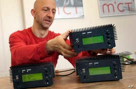 Philipp Hochleichter of the Media in Cooperation and Transmission organization holds a Pocket FM Radio Transmitter in Berlin, Germany, Dec. 21, 2015.