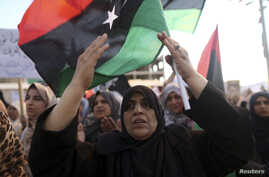 Women take part in a demonstration against the country's parliament and in support of the coalition of fighters called the Benghazi Revolutionaries Shura Council, at Freedom Square in Benghazi August 29, 2014. The demonstrators also protested against