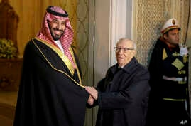 Tunisian President Beji Caid Essebsi, right, shakes hands with Saudi Crown Prince Mohammed bin Salman upon his arrival at the presidential palace in Carthage near Tunis, Nov. 27, 2018. Traveling abroad for the first time since the killing of Saudi jo...