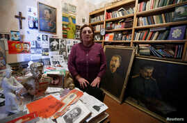 Nazi Stefanishvili, a 73-year-old retired economist, poses for a portrait in a room dedicated to Stalin at her home in Gori, Georgia, Dec. 6, 2016.