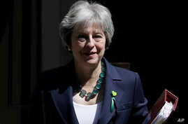 Britain's Prime Minister Theresa May leaves 10 Downing Street, June 13, 2018. May won a vote in Parliament Wednesday over how much control lawmakers should have over the country's departure from the European Union.