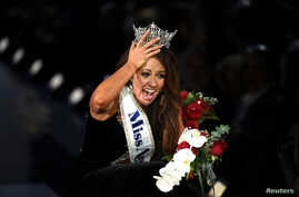 Miss North Dakota Cara Mund reacts after being announced as the winner of the 97th Miss America Competition in Atlantic City, New Jersey U.S. September 10, 2017.