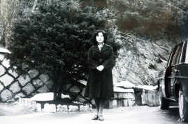 In this undated photo released Nov. 17, 2004, by the Tokyo-based National Association for the Rescue of Japanese Kidnapped by North Korea, Megumi Yokota stands by a car at an unknown place in North Korea after her abduction from her hometown in Japan