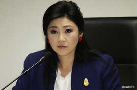 FILE - Prime Minister Yingluck Shinawatra attends her cabinet economic meeting at the office of the Permanent Secretary of Defense in Bangkok.
