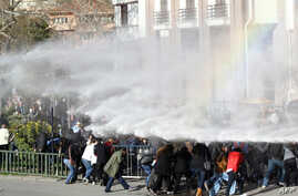 Turkish riot police use water cannon to disperse protesters outside the Supreme Electoral Council (YSK) in Ankara on April 1, 2014.