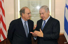 A handout picture released by the US Embassy in Israel shows US Middle East envoy George Mitchell (L) listening to Israeli Prime Minister Benjamin Netanyahu during a meeting in Jerusalem, 20 May 2010