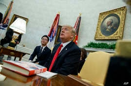 President Donald Trump speaks with reporters about allowing the release of a secret memo on the F.B.I.'s role in the Russia inquiry, during a meeting with North Korean defectors in the Oval Office of the White House, Feb. 2, 2018, in Washington.