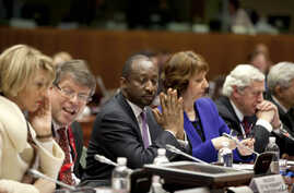 Mali's Foreign Minister Tieman Coulibaly, center, waits for the start of an emergency meeting of EU foreign ministers at the EU Council building in Brussels, Belgium, January 17, 2013.