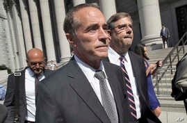 Republican Congressman Christopher Collins leaves federal court in New York, Aug. 8, 2018.