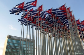 Cuban flags fly beside the United States Interests Section in Havana, Dec. 30, 2014.