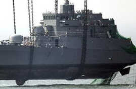 In this April 24, 2010 file photo, a giant offshore crane salvages the bow section of the South Korean naval ship Cheonan
