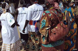 South Sudanese women take part in an event organized by the ACORD NGO to raise awareness of gender-based violence. (Courtesy/ACORD)