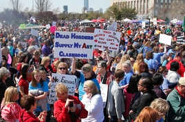 Teachers, students and supporters fill the south plaza of the state Capitol as protests continue over school funding, in Oklahoma City, April 9, 2018.