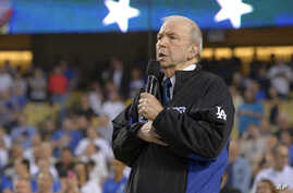 FILE - Frank Sinatra Jr. sings the national anthem prior to a baseball game between the Los Angeles Dodgers and the Pittsburgh Pirates in Los Angeles, Sept. 18, 2015. Sinarta Jr. has died at age 72, his family said.