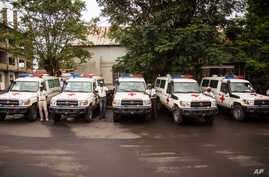 Five ambulances that were donated by the U.S. to help combat the Ebola virus are lined up following a ceremony attended by Sierra Leone's president Ernest Bai Koroma, in Freetown, Sierra Leone, Wednesday, Sept. 10, 2014. The United States donated fiv