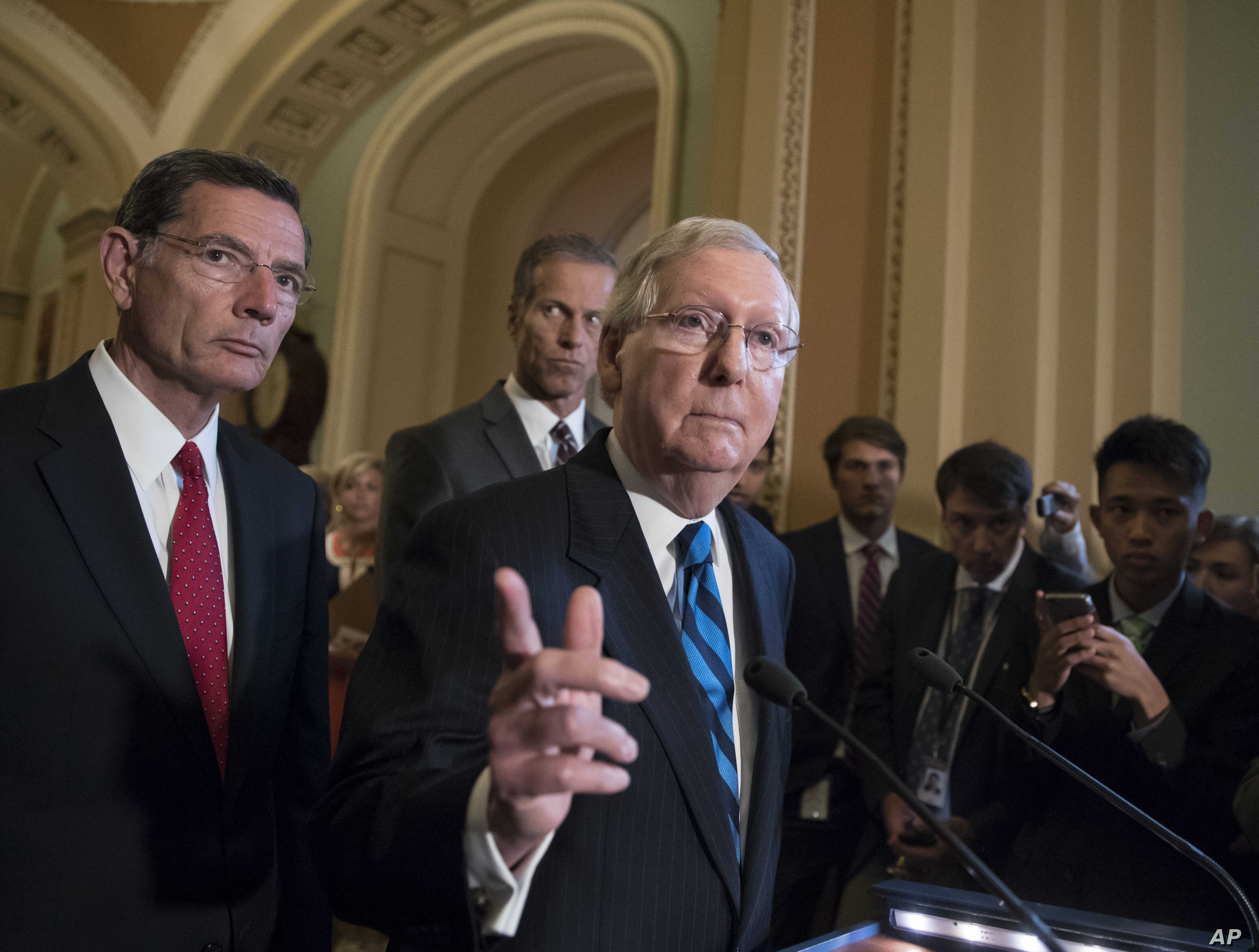 Senate Majority Leader Mitch McConnell of Ky., joined by, from left, Sen. John Barrasso, R-Wyo., and Sen. John Thune, R-S.D., meets with reporters July 11, 2017, on Capitol Hill in Washington.