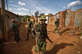 Kenyan police search shack to shack in small alleyways, looking for those commanding stone-throwing opposition protesters, in the Kawangware area of Nairobi, Oct. 28, 2017.  Kenyan opposition areas were generally calmer Saturday, though clashes betwe