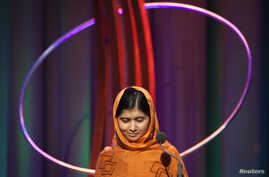 """FILE - Malala Yousafzai gives a speech after receiving the """"Leadership in Civil Society"""" award at the Clinton Global Initiative 2013 in New York September 25, 2013."""