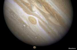 The planet Jupiter is shown with one of its moons, Ganymede (bottom), in this NASA handout taken April 9, 2007 and obtained by Reuters, March 12, 2015.