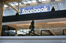 FILE - Facebook logo is displayed in a start-up companies gathering at Paris' Station F, in Paris, Jan. 17, 2017.