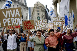 """FILE - Argentinian Peronists rally at the Plaza de Mayo with cardboard posters reading in Spanish; """"Long live Peron,"""" """"Loyal to Peron,"""" """"We love Peron,"""" marking Peronist Loyalty Day, in Buenos Aires, Argentina, Oct. 17, 2013."""