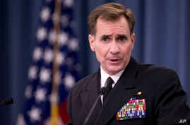 FILE - Rear Admiral John Kirby, the Defense Department spokesman, talks to reporters at the Pentagon.