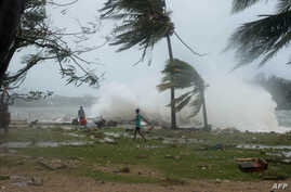 This handout photo taken and received on March 14, 2015 by UNICEF Pacific shows waves and scattered debris along the coast, caused by Cyclone Pam, in the Vanuatu capital of Port Vila.