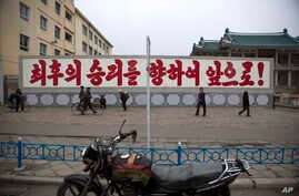 """FILE - A propaganda billboard, which reads """"Forward to the Ultimate Victory"""" in Korean is seen standing in central Kaesong, North Korea."""