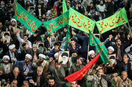 Iranians chant slogans as they march in support of the government near the Imam Khomeini grand mosque in the capital Tehran on Dec. 30, 2017.