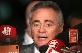 Senate leader Renan Calheiros addresses the press at the National Congress in Brasilia, Brazil, Tuesday, Dec. 6, 2016.  Calheiros has refused to step down until the full Supreme Court rules on his future, Wednesday, Dec. 7, 2016.