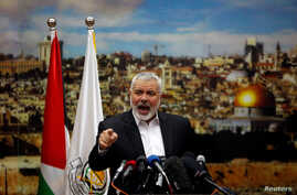 Hamas Chief Ismail Haniyeh gestures as he delivers a speech over U.S. President Donald Trump's decision to recognize Jerusalem as the capital of Israel, in Gaza City, Dec. 7, 2017.