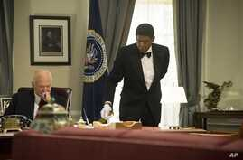 """Robin Williams as Dwight Eisenhower, left, and Forest Whitaker as Cecil Gaines in a scene from """"Lee Daniels' The Butler,"""" undated film image released by The Weinstein Company."""