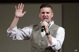 FILE - In this Dec. 6, 2016 file photo, Richard Spencer, who leads a movement that mixes racism, white nationalism and populism, speaks at the Texas A&M University campus in College Station, Texas.